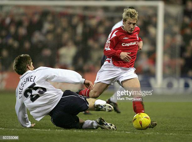 Kris Commons of Nottingham Forest is challenged by Richard Cresswell of Preston during the Coca Cola Championship match between Nottingham Forest and...