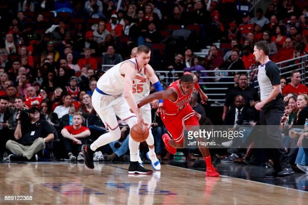 Kris Dunn of the Chicago Bulls and Kristaps Porzingis of the New York Knicks fight for possession of the ball against the New York Knicks on December...