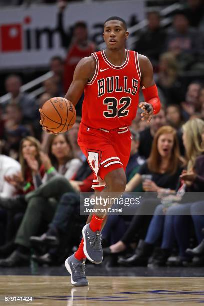 Kris Dunn of the Chicago Bulls brings the ball up the court against the Charlotte Hornets at the United Center on November 17 2017 in Chicago...