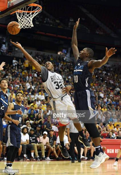 Kris Dunn of the Chicago Bulls drives to the basket against Dorian FinneySmith of the Dallas Mavericks during the 2017 Summer League at the Thomas...