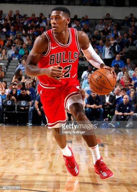Kris Dunn of the Chicago Bulls handles the ball against the Dallas Mavericks during the preseason game on October 4 2017 at the American Airlines...