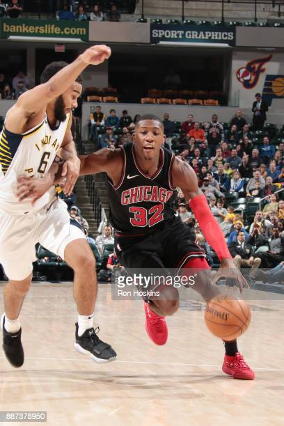 Kris Dunn of the Chicago Bulls handles the ball against the Indiana Pacers on December 6 2017 at Bankers Life Fieldhouse in Indianapolis Indiana NOTE...