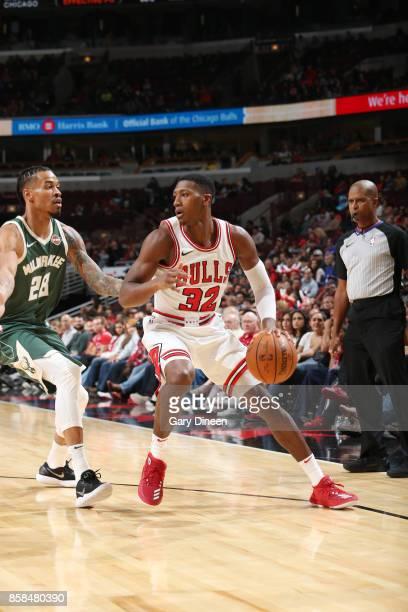 Kris Dunn of the Chicago Bulls handles the ball against the Milwaukee Bucks during the preseason game on October 6 2017 at the United Center in...