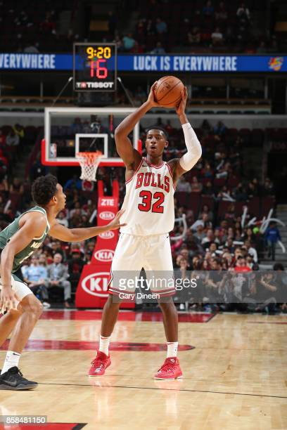 Kris Dunn of the Chicago Bulls passes the ball against the Milwaukee Bucks during the preseason game on October 6 2017 at the United Center in...