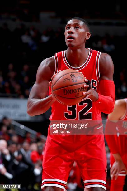Kris Dunn of the Chicago Bulls shoots a free throw against the New York Knicks on December 9 2017 at the United Center in Chicago Illinois NOTE TO...