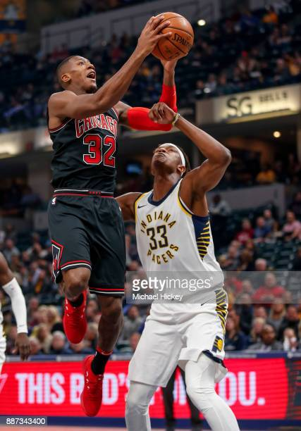 Kris Dunn of the Chicago Bulls shoots the ball against Myles Turner of the Indiana Pacers at Bankers Life Fieldhouse on December 6 2017 in...