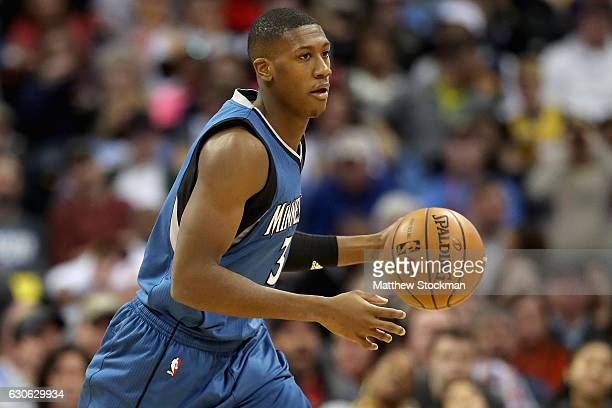 Kris Dunn of the Minnesota Timberwolves brings the ball down court against the Denver Nuggets at the Pepsi Center on December 28 2016 in Denver...