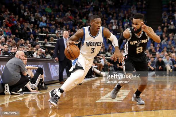 Kris Dunn of the Minnesota Timberwolves drives to the basket against the San Antonio Spurs on March 21 2017 at Target Center in Minneapolis Minnesota...