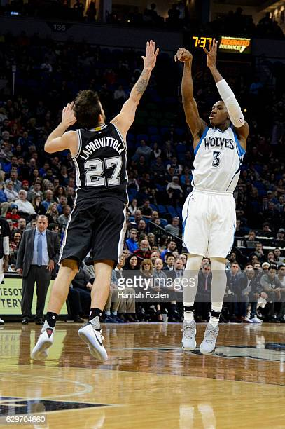 Kris Dunn of the Minnesota Timberwolves shoots a threepoint basket against Nicolas Laprovittola of the San Antonio Spurs during the game on December...