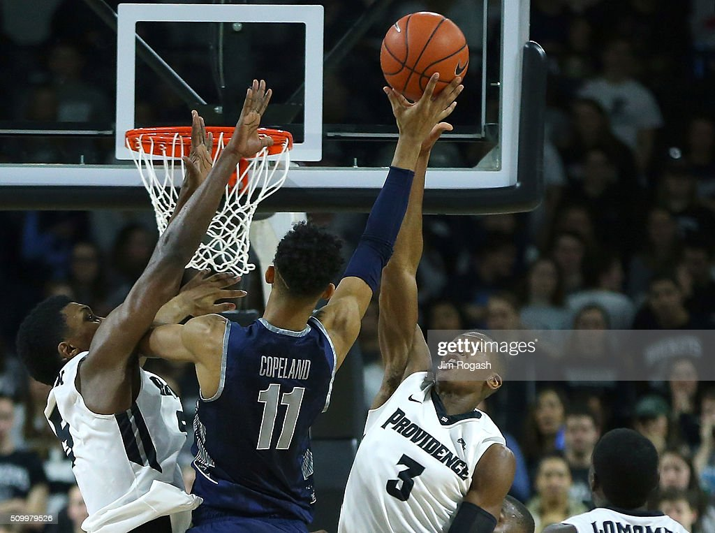 <a gi-track='captionPersonalityLinkClicked' href=/galleries/search?phrase=Kris+Dunn&family=editorial&specificpeople=7887137 ng-click='$event.stopPropagation()'>Kris Dunn</a> #3 of the Providence Friars blocks the shot of <a gi-track='captionPersonalityLinkClicked' href=/galleries/search?phrase=Isaac+Copeland&family=editorial&specificpeople=11049636 ng-click='$event.stopPropagation()'>Isaac Copeland</a> #11 of the Georgetown Hoyas in the first half on February 13, 2016, at the Dunkin' Donuts Center in Providence, Rhode Island.