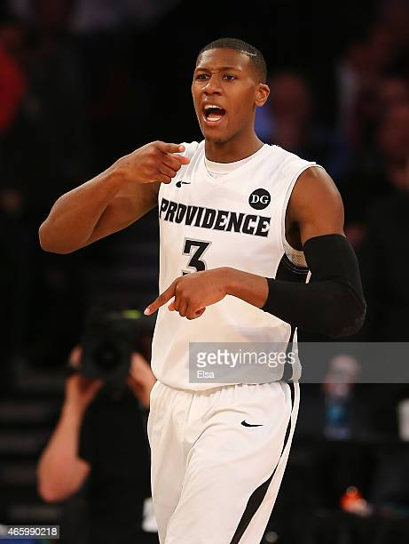 Kris Dunn of the Providence Friars celebrates after he drew the foul in the first half against the St John's Red Storm during a quarterfinal game of...