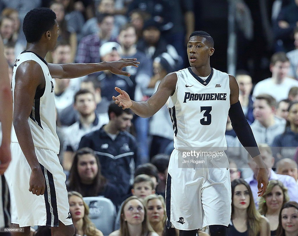 Kris Dunn #3 of the Providence Friars celebrates with Rodney Bullock #5 after he was fouled by the Georgetown Hoyas in the first half on February 13, 2016, at the Dunkin' Donuts Center in Providence, Rhode Island.