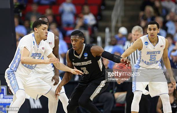 Kris Dunn of the Providence Friars drives against Justin Jackson of the North Carolina Tar Heels in the second half during the second round of the...