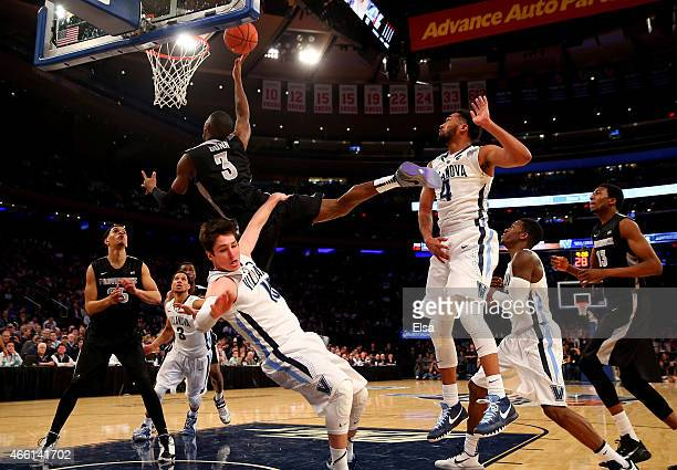 Kris Dunn of the Providence Friars drives to the basket against Ryan Arcidiacono of the Villanova Wildcats in the first half during a semifinal game...