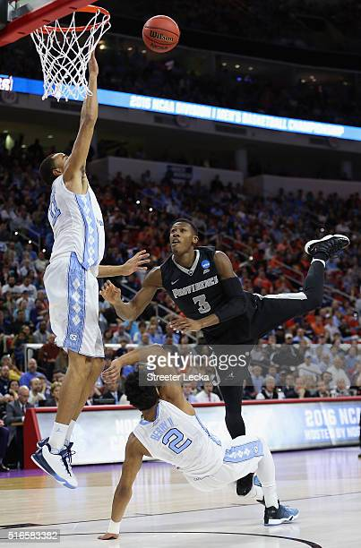 Kris Dunn of the Providence Friars shoots over Brice Johnson and Joel Berry II of the North Carolina Tar Heels in the first half during the second...