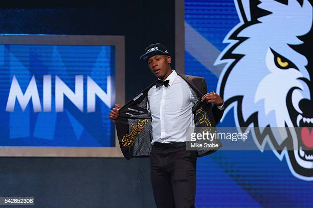 Kris Dunn walks on stage after being drafted fifth overall by the Minnesota Timberwolves in the first round of the 2016 NBA Draft at the Barclays...