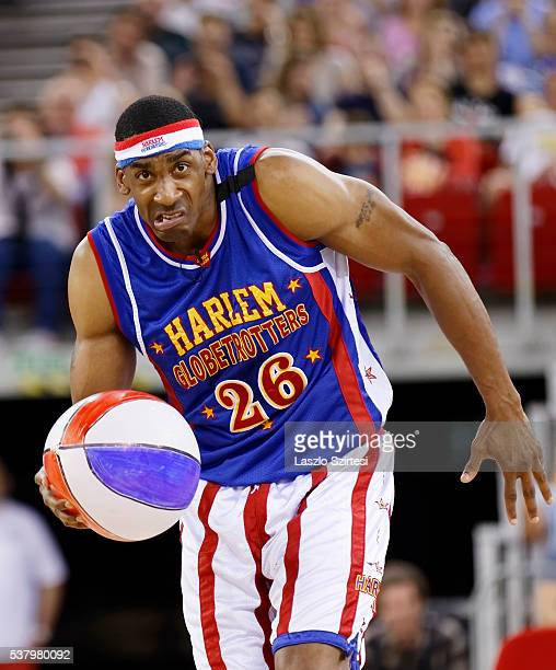 Kris 'HiLite' Bruton of Harlem Globetrotters controls a beach ball during the exhibition game between Harlem Globetrotters and World AllStars at...