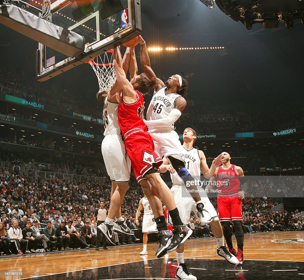 Kris Humphries #43 and Gerald Wallace #45 of the Brooklyn Nets attempt to block Joakim Noah #13 of the Chicago Bulls in Game Five of the Eastern Conference Quarterfinals during the 2013 NBA Playoffs on April 29 at the Barclays Center in the Brooklyn borough of New York City.