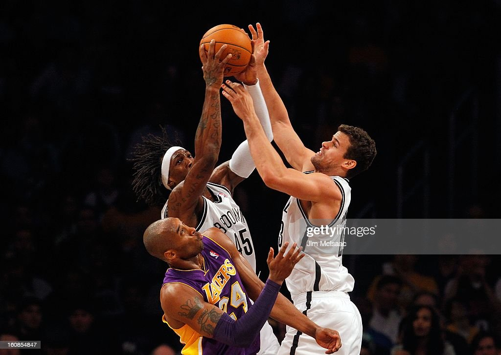 Kris Humphries #43 and Gerald Wallace #45 of the Brooklyn Nets grab a rebound against Kobe Bryant #24 of the Los Angeles Lakers at Barclays Center on February 5, 2013 in the Brooklyn borough of New York City.The Lakers defeated the Nets 92-83.