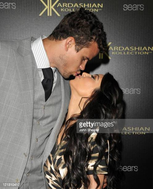 Kris Humphries and Kim Kardashian attend the Kardashian Kollection Launch Party at The Colony on August 17 2011 in Hollywood California