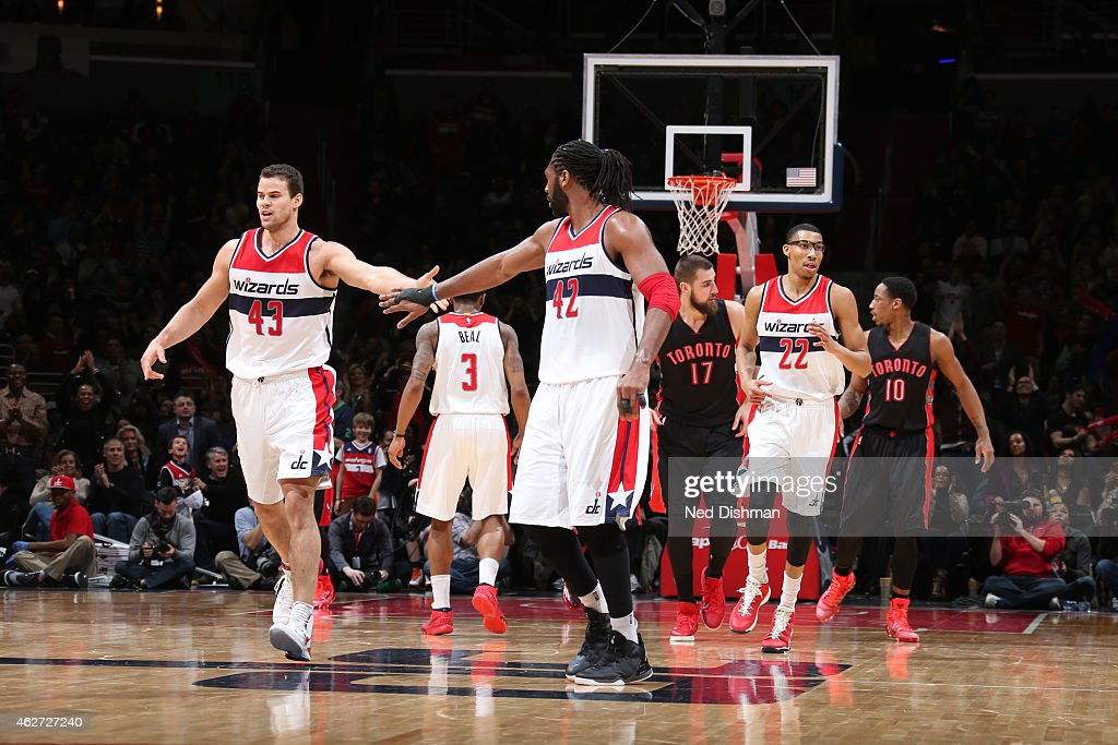Kris Humphries #43 and Nene #42 of the Washington Wizards celebrate during a game against the Toronto Raptors on January 31, 2015 at Verizon Center in Washington, DC.