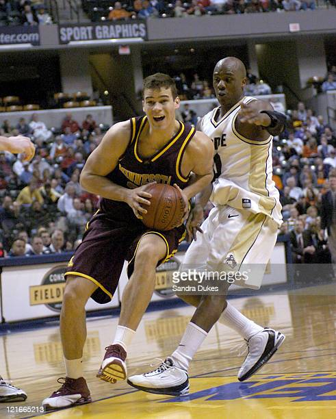 Kris Humphries drives past Kenneth Lowe in the first half of Minnesota's 6352 win