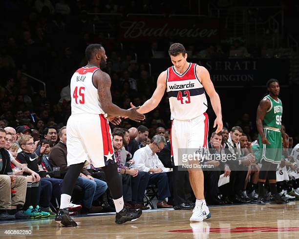 Kris Humphries high fives teammate DeJuan Blair of the Washington Wizards during the game on December 27 2014 at Verizon Center in Washington...
