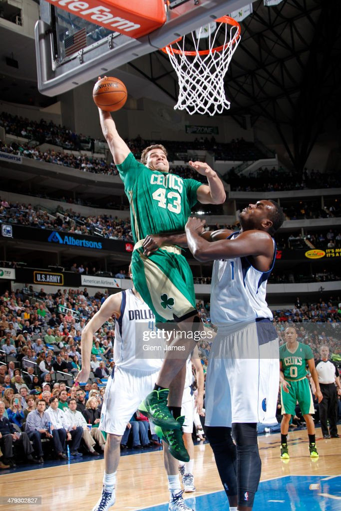 Kris Humphries #43 of the Boston Celtics dunks against the Dallas Mavericks on March 17, 2014 at the American Airlines Center in Dallas, Texas.