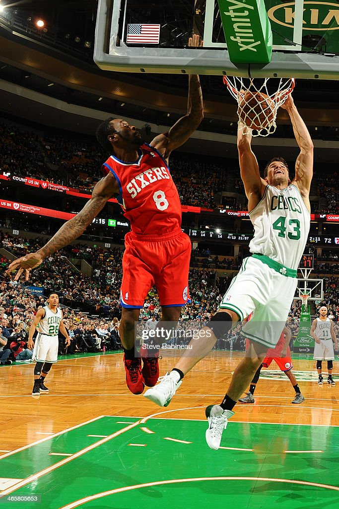 Kris Humphries of the Boston Celtics dunks the ball against Tony Wroten of the Philadelphia 76ers on January 29 2014 at the TD Garden in Boston...