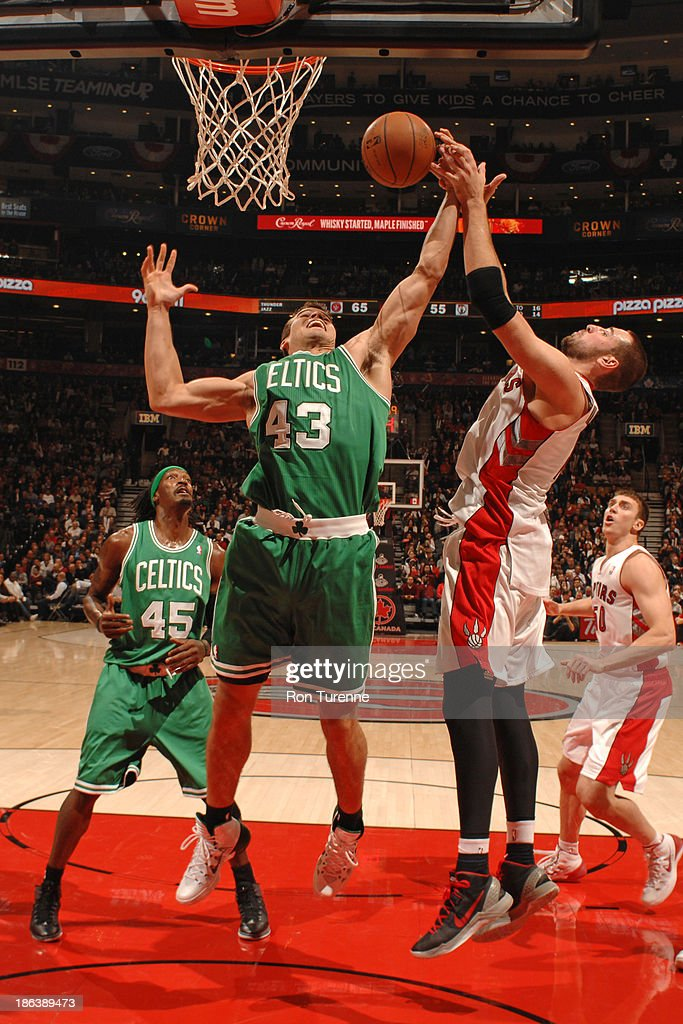 Kris Humphries #43 of the Boston Celtics grabs a rebound against the Toronto Raptors during the game on October 23, 2013 at the Air Canada Centre in Toronto, Ontario, Canada.