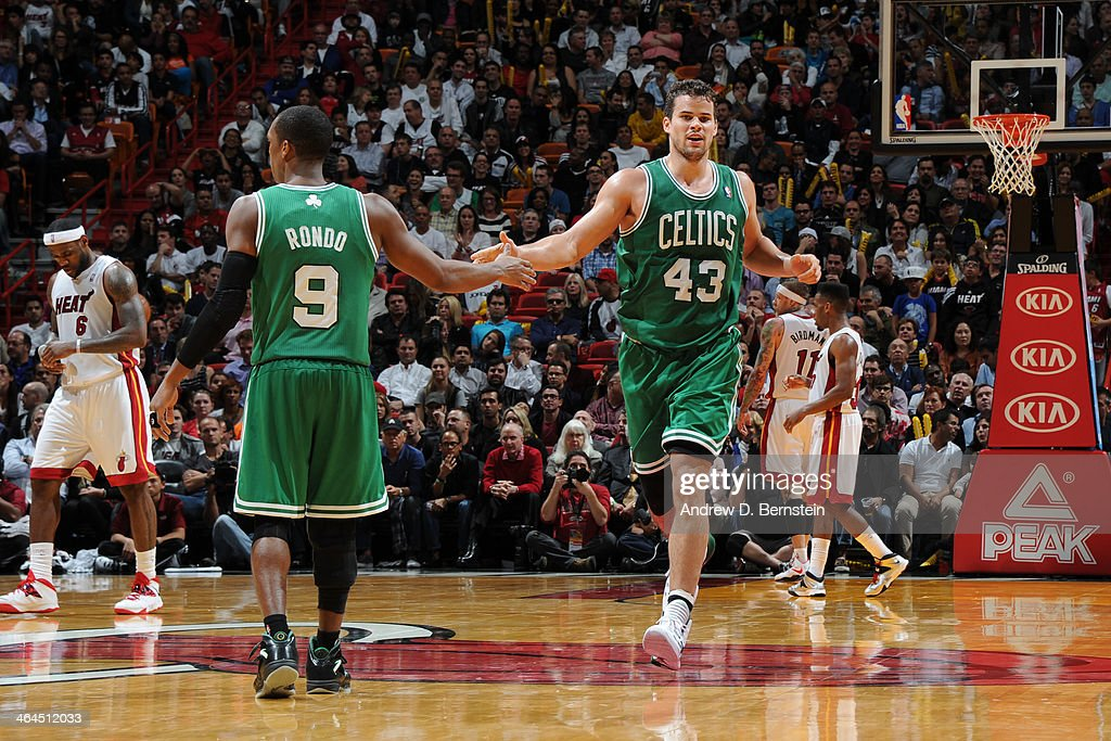 <a gi-track='captionPersonalityLinkClicked' href=/galleries/search?phrase=Kris+Humphries&family=editorial&specificpeople=209199 ng-click='$event.stopPropagation()'>Kris Humphries</a> #43 of the Boston Celtics high fives <a gi-track='captionPersonalityLinkClicked' href=/galleries/search?phrase=Rajon+Rondo&family=editorial&specificpeople=206983 ng-click='$event.stopPropagation()'>Rajon Rondo</a> #9 during the game against the Miami Heat at the American Airlines Arena in Miami, Florida on January 21, 2014.