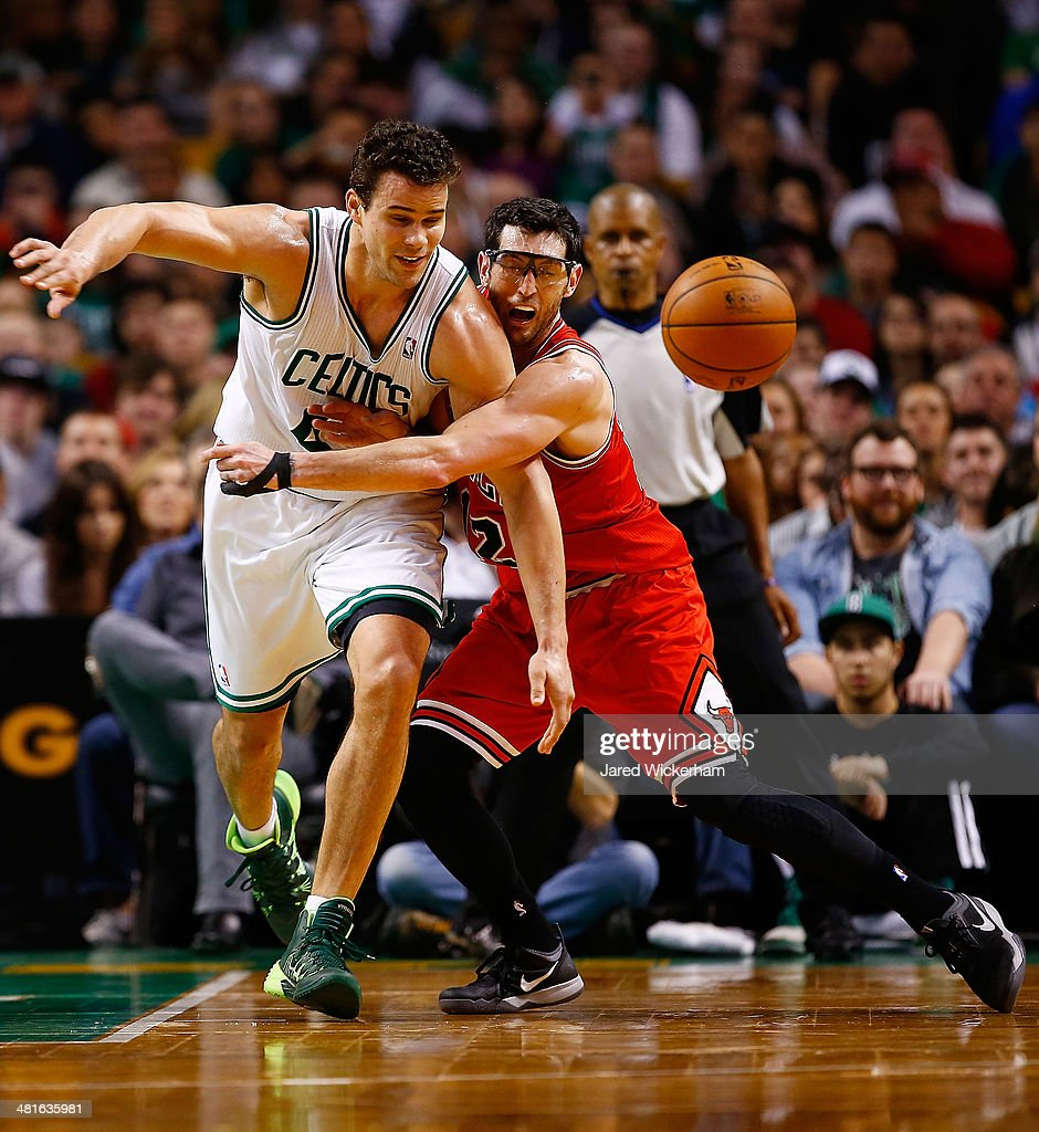 Kris Humphries #43 of the Boston Celtics loses control of the ball in front of Kirk Hinrich #12 of the Chicago Bulls in the second half during the game at TD Garden on March 30, 2014 in Boston, Massachusetts.