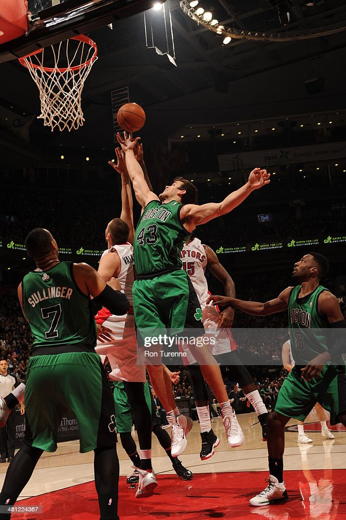 Kris Humphries #43 of the Boston Celtics rebounds against the Toronto Raptors on March 28, 2014 at the Air Canada Centre in Toronto, Ontario, Canada.