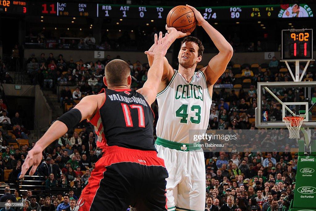 Kris Humphries #43 of the Boston Celtics shoots against Jonas Valanciunas #17 of the Toronto Raptors on March 26, 2014 at the TD Garden in Boston, Massachusetts.
