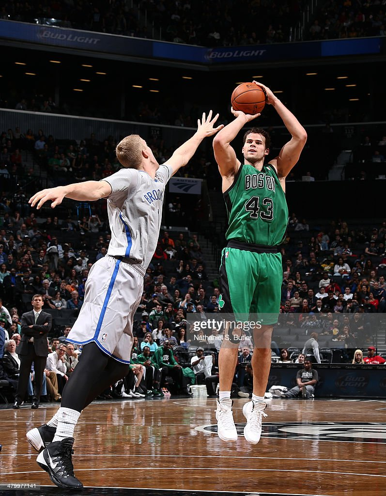 Kris Humphries #43 of the Boston Celtics shoots against Mason Plumlee #1 of the Brooklyn Nets during a game at the Barclays Center on March 21, 2014 in the Brooklyn borough of New York City.