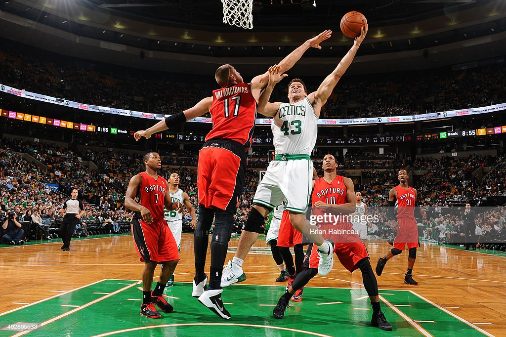 <a gi-track='captionPersonalityLinkClicked' href=/galleries/search?phrase=Kris+Humphries&family=editorial&specificpeople=209199 ng-click='$event.stopPropagation()'>Kris Humphries</a> #43 of the Boston Celtics shoots the ball against <a gi-track='captionPersonalityLinkClicked' href=/galleries/search?phrase=Jonas+Valanciunas&family=editorial&specificpeople=5654195 ng-click='$event.stopPropagation()'>Jonas Valanciunas</a> #17 of the Toronto Raptors on January 15, 2014 at the TD Garden in Boston, Massachusetts.