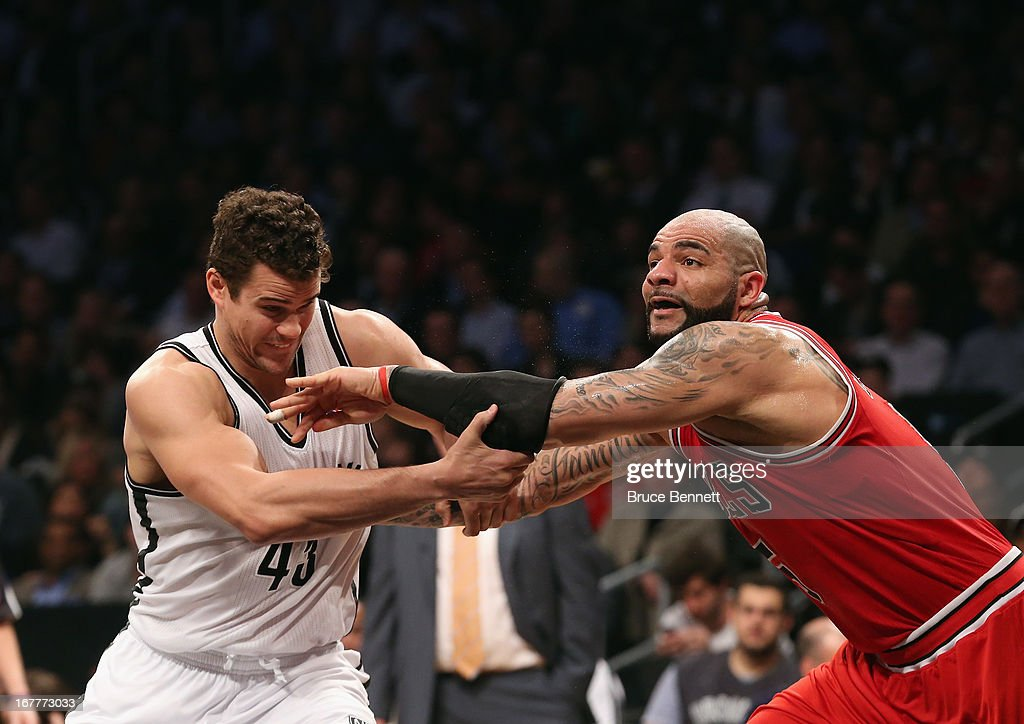 Kris Humphries #43 of the Brooklyn Nets and Carlos Boozer #5 of the Chicago Bulls battle for position during Game Five of the Eastern Conference Quarterfinals of the 2013 NBA Playoffs at the Barclays Center on April 29, 2013 in New York City. The Nets defeated the Bulls 110-91.