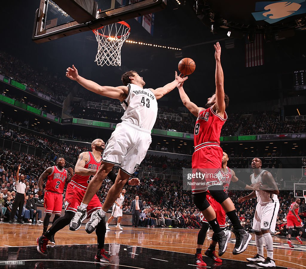 Kris Humphries #43 of the Brooklyn Nets and Marco Belinelli #8 of the Chicago Bulls fight for a rebound during Game Five of the Eastern Conference Quarterfinals during the 2013 NBA Playoffs on April 29 at the Barclays Center in the Brooklyn borough of New York City.
