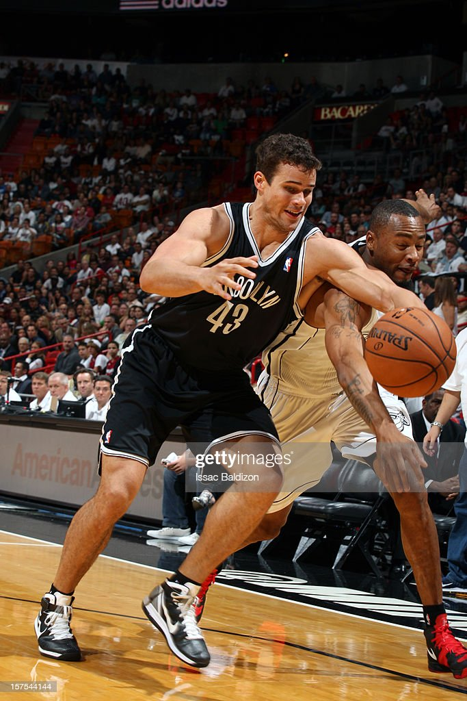 Kris Humphries #43 of the Brooklyn Nets and Rashard Lewis #9 of the Miami Heat fight for the loose ball during the game on December 1, 2012 at American Airlines Arena in Miami, Florida.
