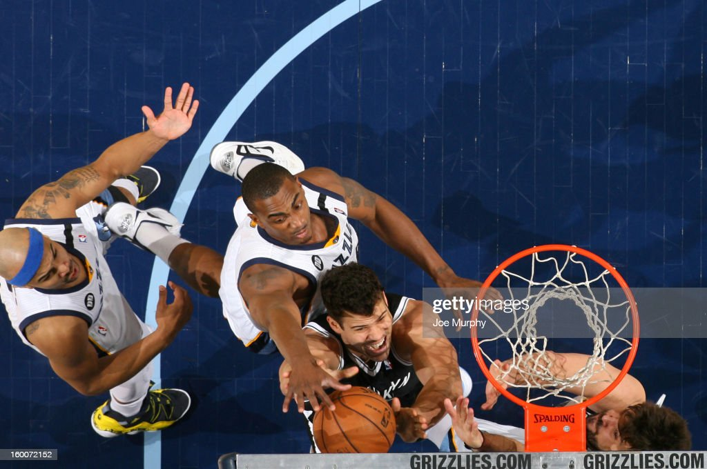 Kris Humphries #43 of the Brooklyn Nets attempts a layup against Darrell Arthur #00 of the Memphis Grizzlies on January 25, 2013 at FedExForum in Memphis, Tennessee.