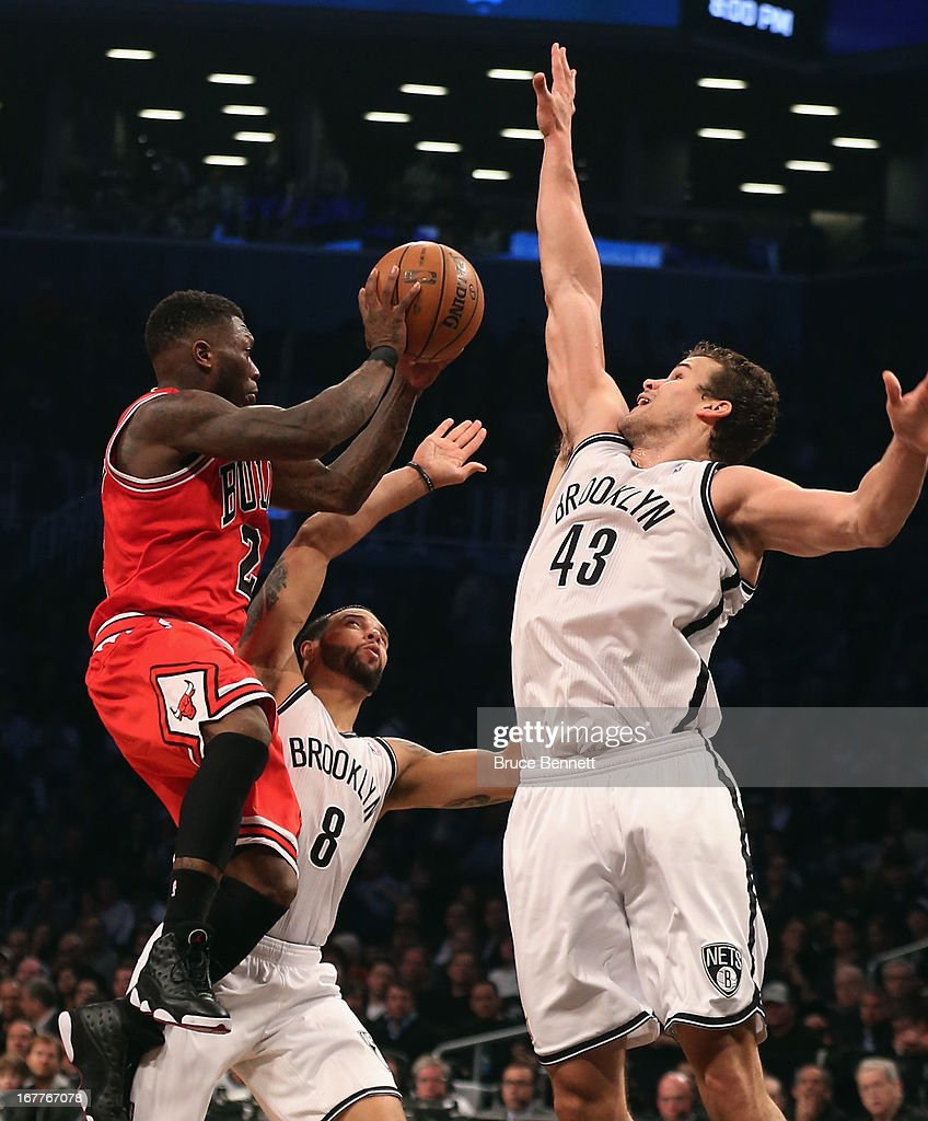 Kris Humphries #43 of the Brooklyn Nets blocks Nate Robinson #2 of the Chicago Bulls during Game Five of the Eastern Conference Quarterfinals of the 2013 NBA Playoffs at the Barclays Center on April 29, 2013 in New York City.