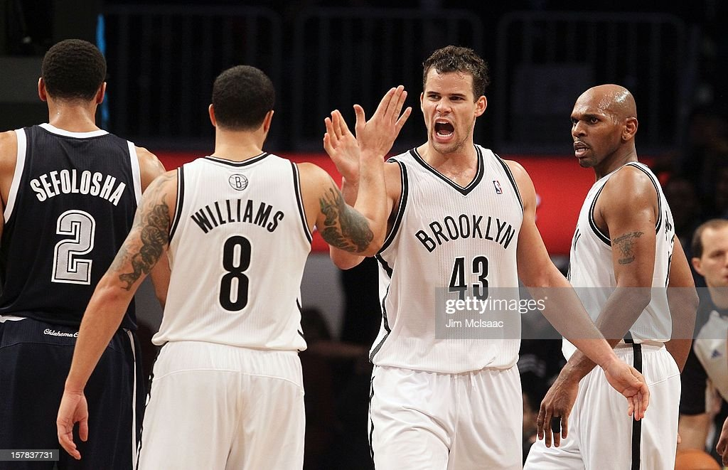 Kris Humphries #43 of the Brooklyn Nets celebrates a basket against the Oklahoma City Thunder with teammate Deron Williams #8 at Barclays Center on December 4, 2012 in the Brooklyn borough of New York City.The Thunder defeated the Nets 117-111.