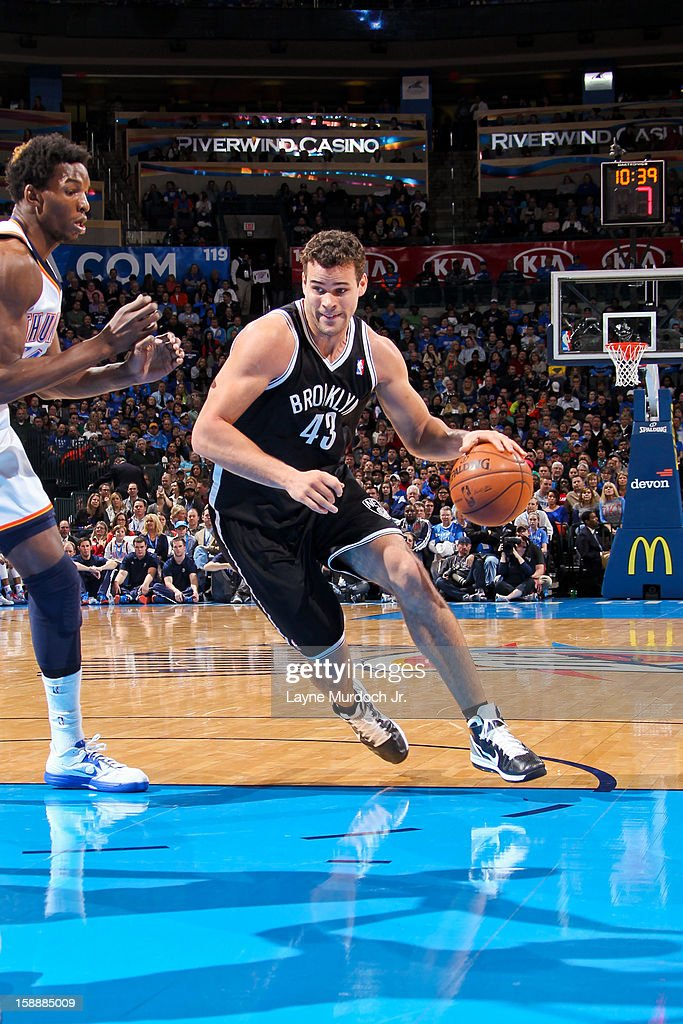 Kris Humphries #43 of the Brooklyn Nets drives to the basket against Hasheem Thabeet #34 of the Oklahoma City Thunder on January 2, 2013 at the Chesapeake Energy Arena in Oklahoma City, Oklahoma.