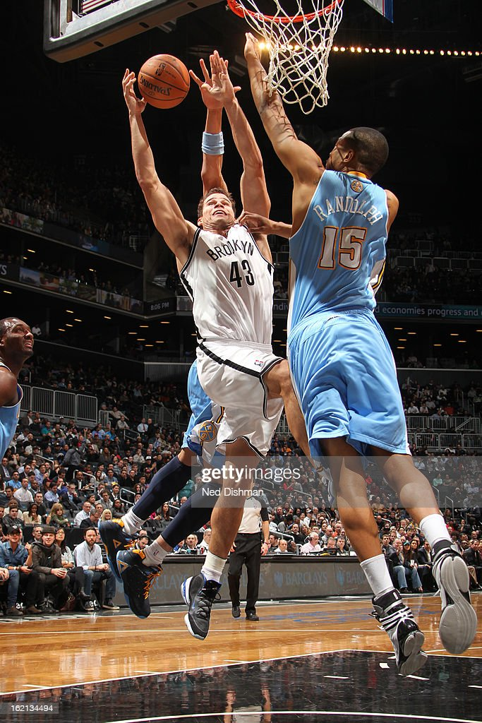 Kris Humphries #43 of the Brooklyn Nets drives to the basket against Anthony Randolph #15 of the Denver Nuggets on February 13, 2013 at the Barclays Center in the Brooklyn borough of New York City in New York City.