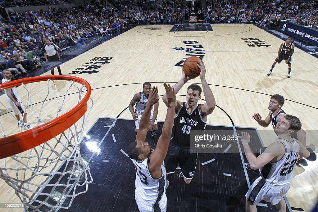 Kris Humphries #43 of the Brooklyn Nets drives to the basket against the San Antonio Spurs on December 31, 2012 at the AT&T Center in San Antonio, Texas.
