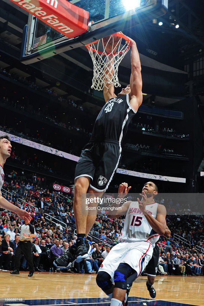 Kris Humphries #43 of the Brooklyn Nets dunks against Al Horford #15 of the Atlanta Hawks on January 16, 2013 at Philips Arena in Atlanta, Georgia.