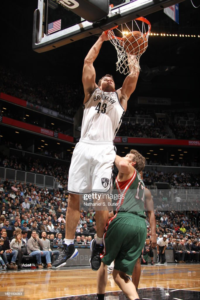 Kris Humphries #43 of the Brooklyn Nets dunks against Mike Dunleavy #17 of the Milwaukee Bucks on February 19, 2013 at the Barclays Center in the Brooklyn borough of New York City.