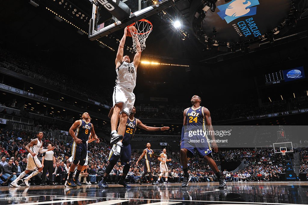 Kris Humphries #43 of the Brooklyn Nets dunks against Paul Millsap #24 of the Utah Jazz during the game at the Barclays Center on December 18, 2012 in Brooklyn, New York.