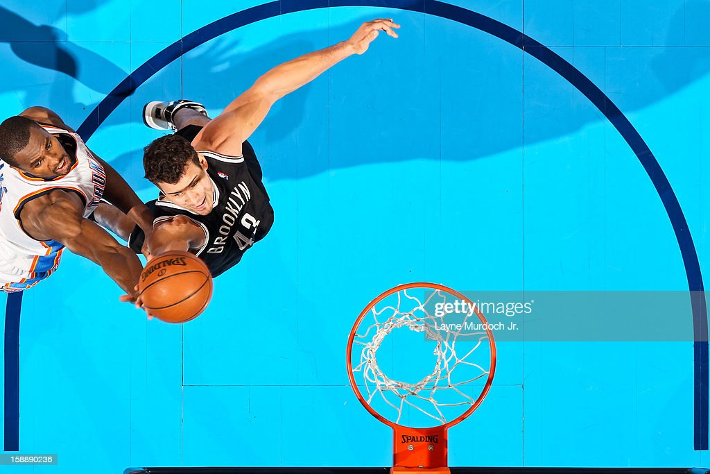<a gi-track='captionPersonalityLinkClicked' href=/galleries/search?phrase=Kris+Humphries&family=editorial&specificpeople=209199 ng-click='$event.stopPropagation()'>Kris Humphries</a> #43 of the Brooklyn Nets fights for a rebound against <a gi-track='captionPersonalityLinkClicked' href=/galleries/search?phrase=Serge+Ibaka&family=editorial&specificpeople=5133378 ng-click='$event.stopPropagation()'>Serge Ibaka</a> #9 of the Oklahoma City Thunder on January 2, 2013 at the Chesapeake Energy Arena in Oklahoma City, Oklahoma.