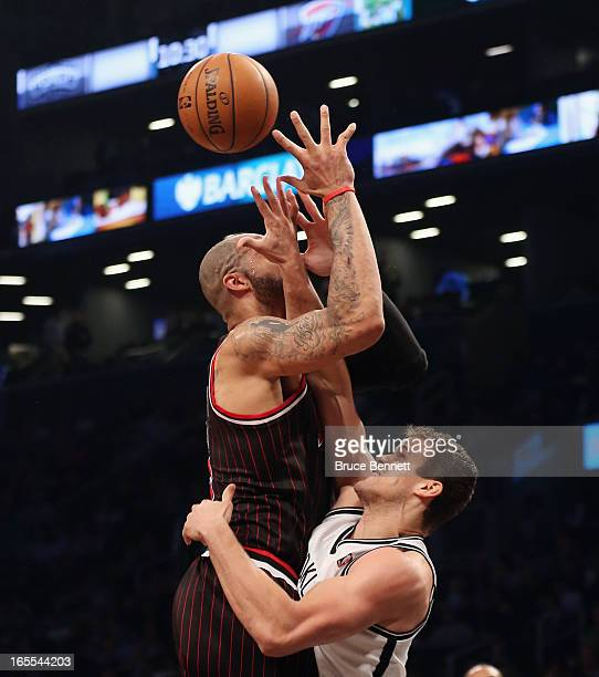 Kris Humphries of the Brooklyn Nets fouls Carlos Boozer of the Chicago Bulls in the second quarter at the Barclays Center on April 4 2013 in New York...